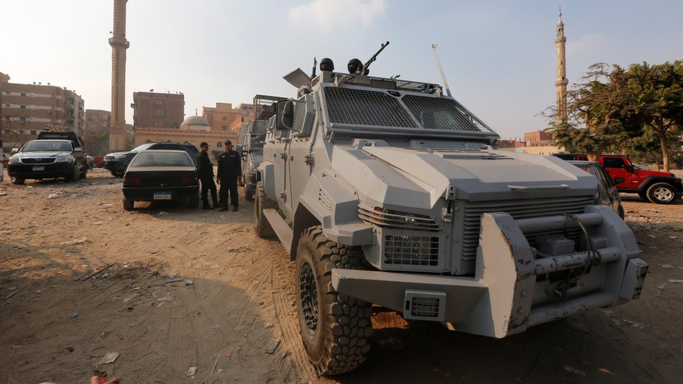 Security forces stand guard at the site of attack on a church in the Helwan district south of Cairo, Egypt on 29 December 2017