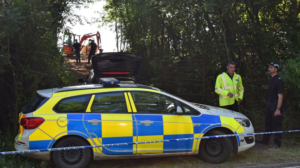 Police officers search an area near Pershore in Worcestershire