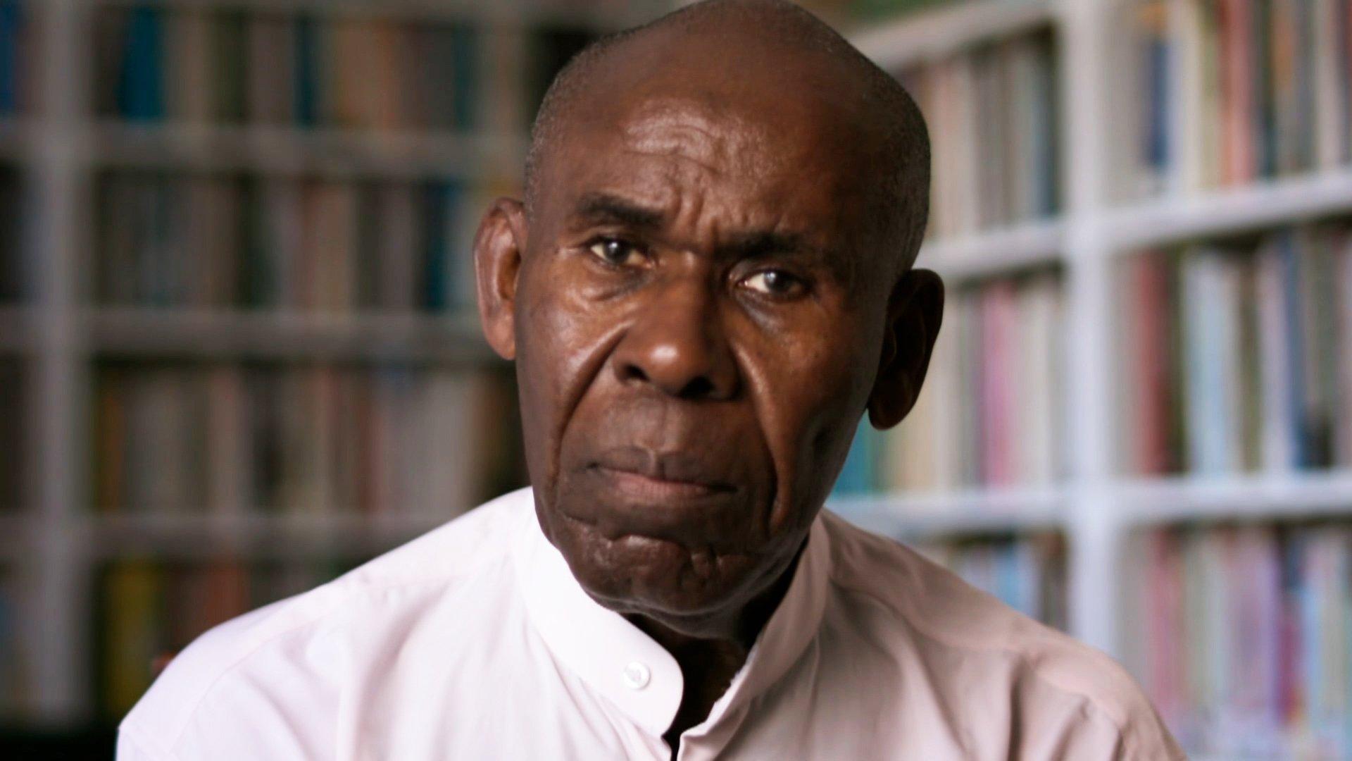 Gus John, activista y académico.