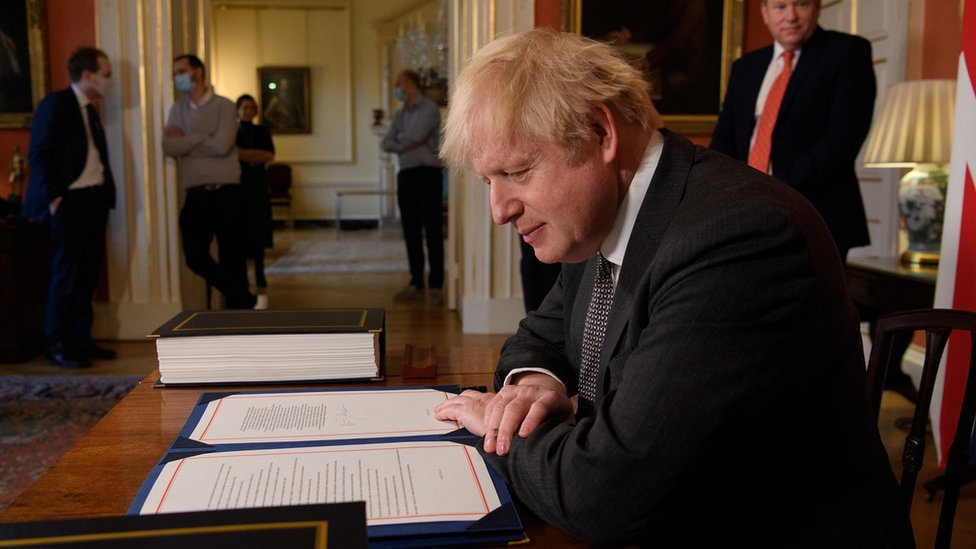 PM Boris Johnson signs the post-Brexit trade deal with the EU on 30 December 2020