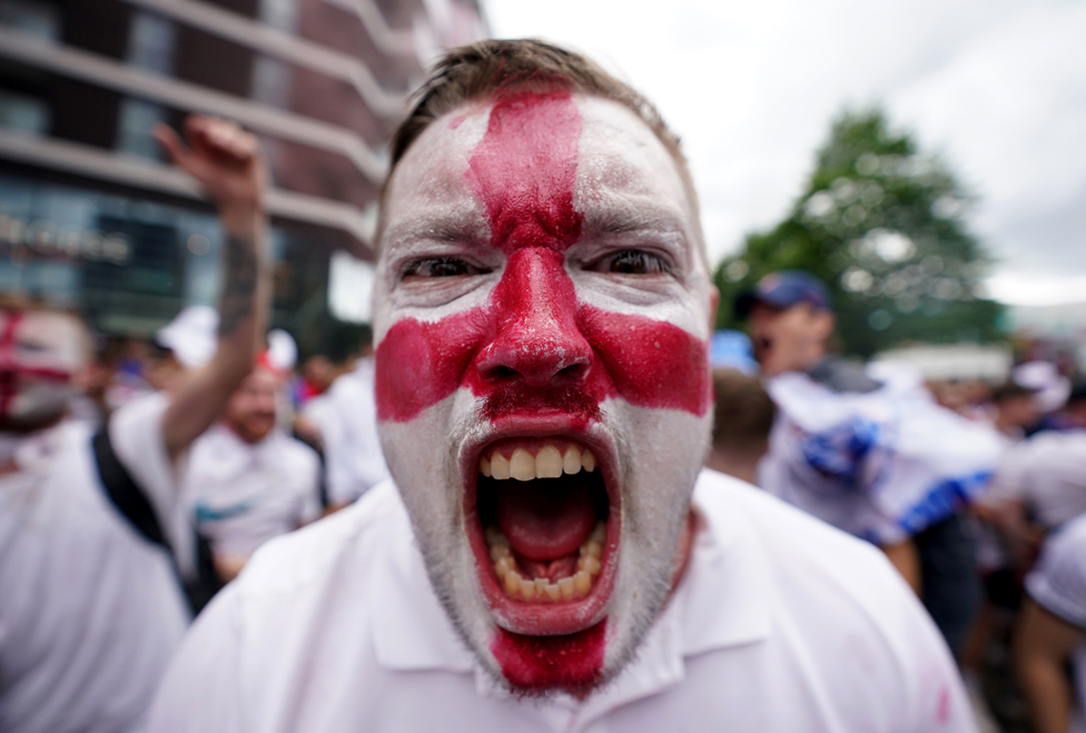 An England fan with a painted face outside Wembley Stadium, London, on 11 July 2021