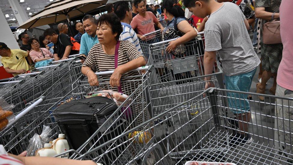 La gente en su visita a China.