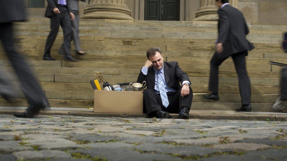 Banker on steps of bank