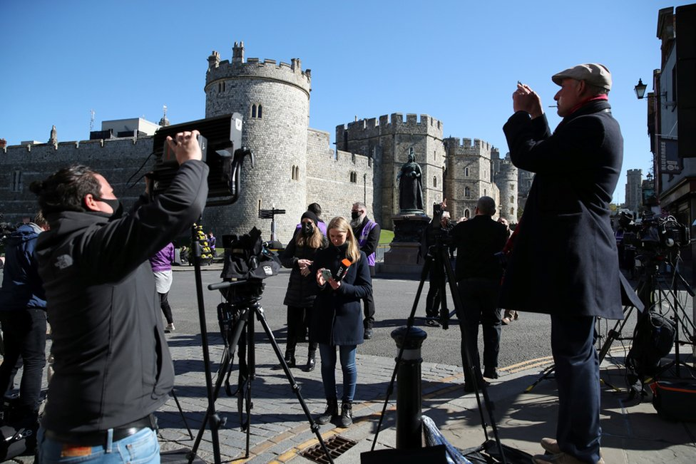 Members of the media gather outside Windsor Castle on the day of the funeral of Britain's Prince Philip, husband of Queen Elizabeth, who died at the age of 99, in Windsor, near London, April 17, 2021.