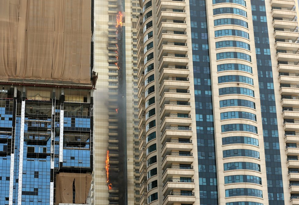 Flames and charring are visible on the outside of more than 30 storeys, 20 July 2016