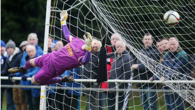 Welders' goalkeeper Michael Dougherty fails to save a Glenavon free-kick from Andy Hall