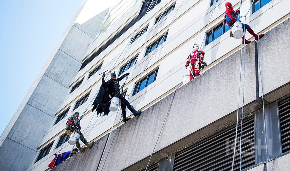 The Superheroes scale the walls of the hopsital