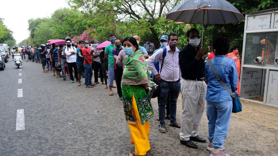 People wait in queue for their turn for COVID-19 testing at a test centre at Ghaziabad in Uttar Pradesh, India on April 23, 2021