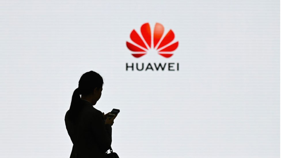 Woman in front of Huawei logo