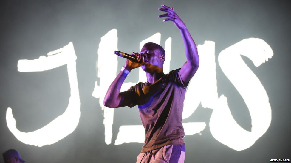 This is a photo of J HUS performing.
