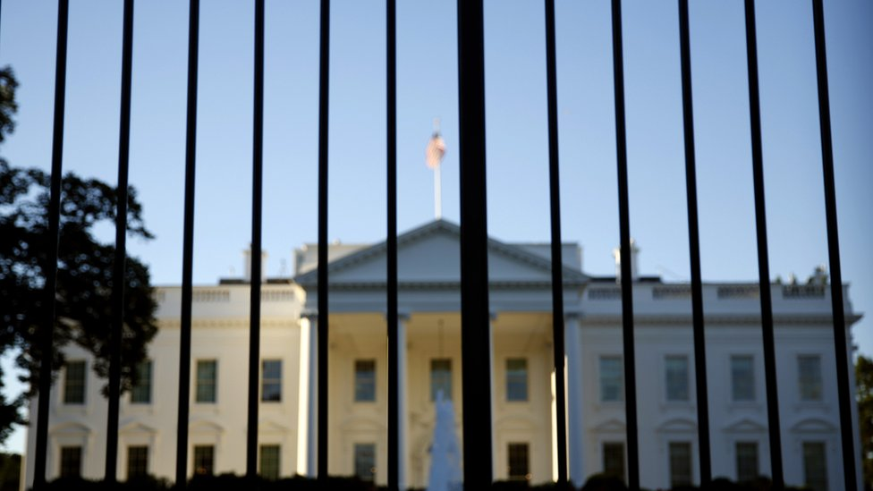 The White House photographed behind bars outside the residence