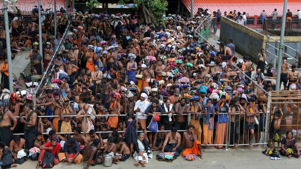 Hindu devotees wait inside the premises of the Sabarimala temple in Pathanamthitta district in the southern state of Kerala