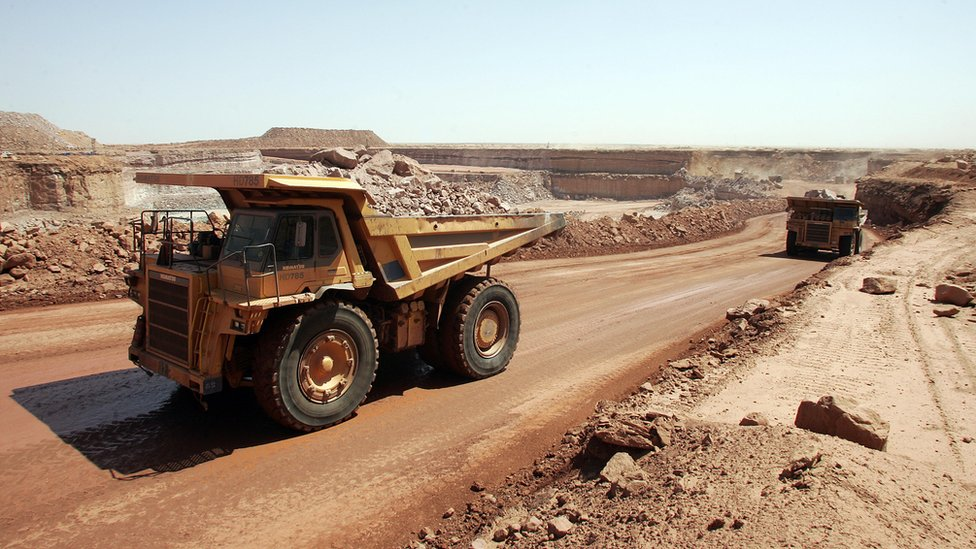 Trucks at an open cast mine in Niger