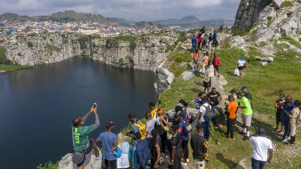 Tourists at Mpape Crushed Rock near Abuja, Nigeria