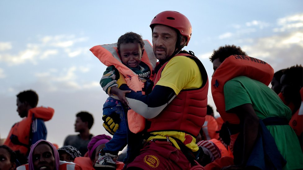 Spanish lifeguards mount a rescue operation off Libya in October 2016