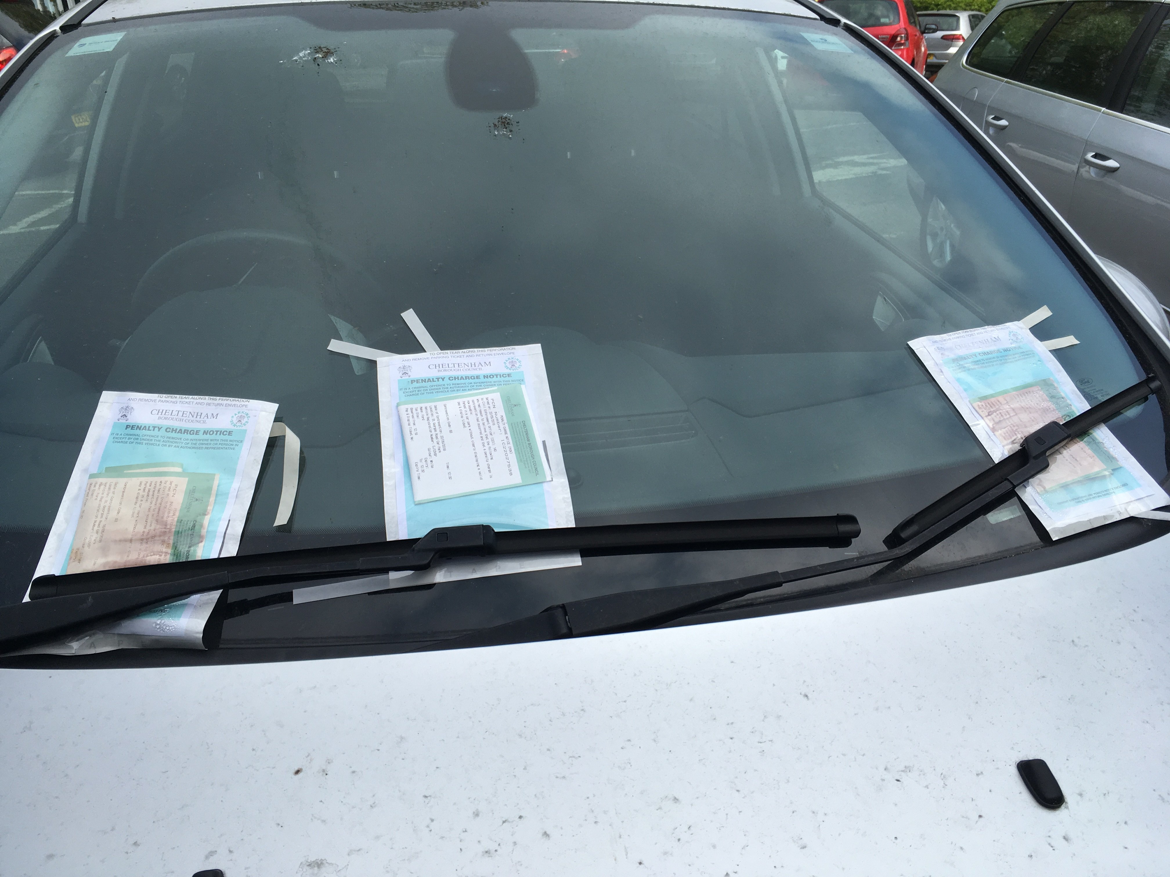 Car covered in parking tickets