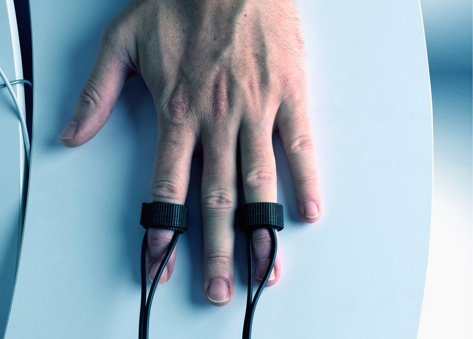 A hand with sensors attached.