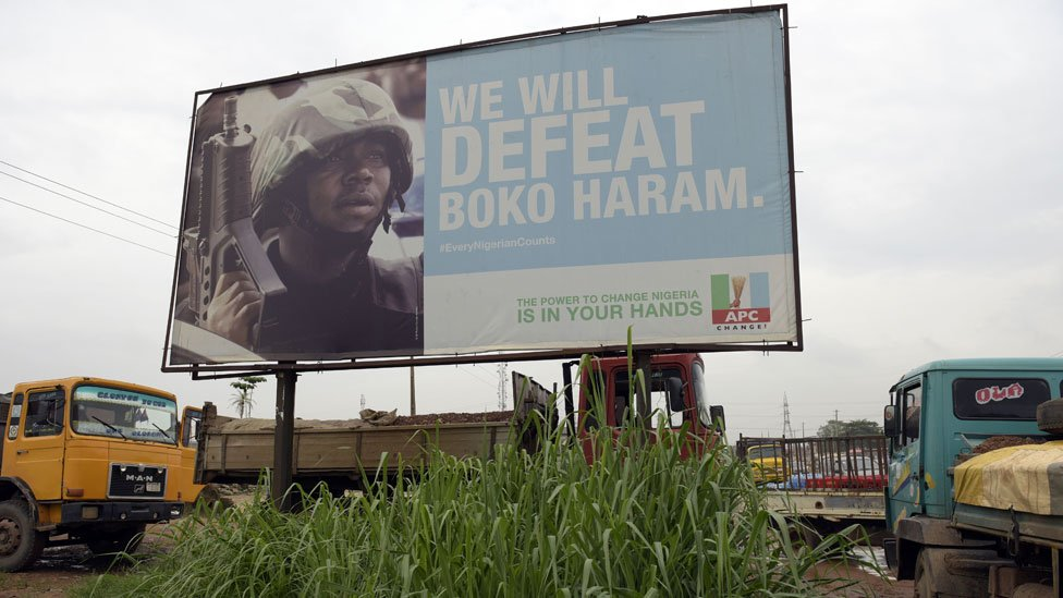 Campaign signboard displayed by the ruling All Progressives Congress (APC) to show its readiness to defeat Boko Haram Islamists on assumption office at Ogijo, Ogun State in southwest Nigeria, on July 3, 2015