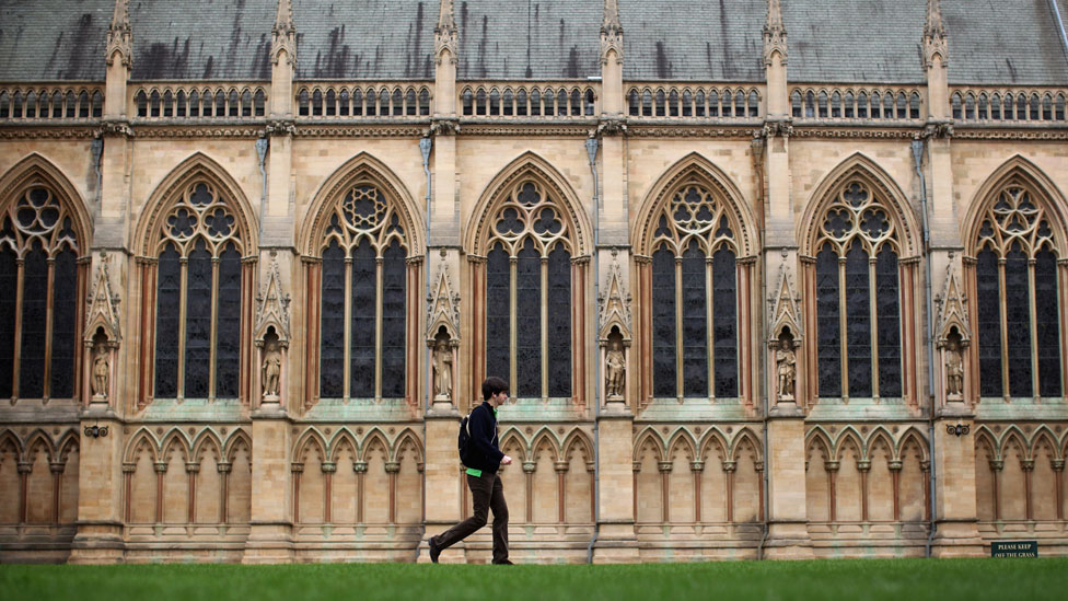 Student outside a building at University of Cambridge