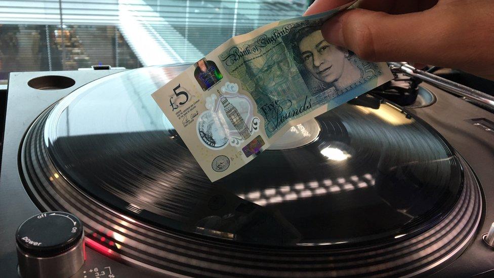 Fiver playing vinyl