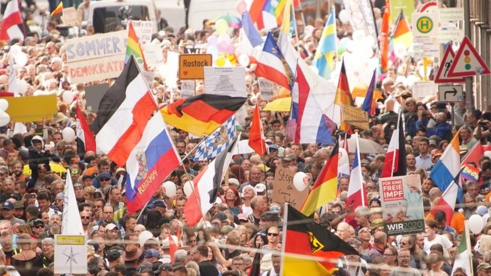 Demonstrators with various flags of Germany, Russia, Netherlands, German Empire and Bavaria protest against coronavirus pandemic regulations in Berlin, Germany, 29 August 2020.