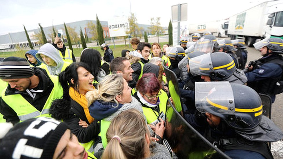 Yellow vest protestors outside an Amazon warehouse in France.