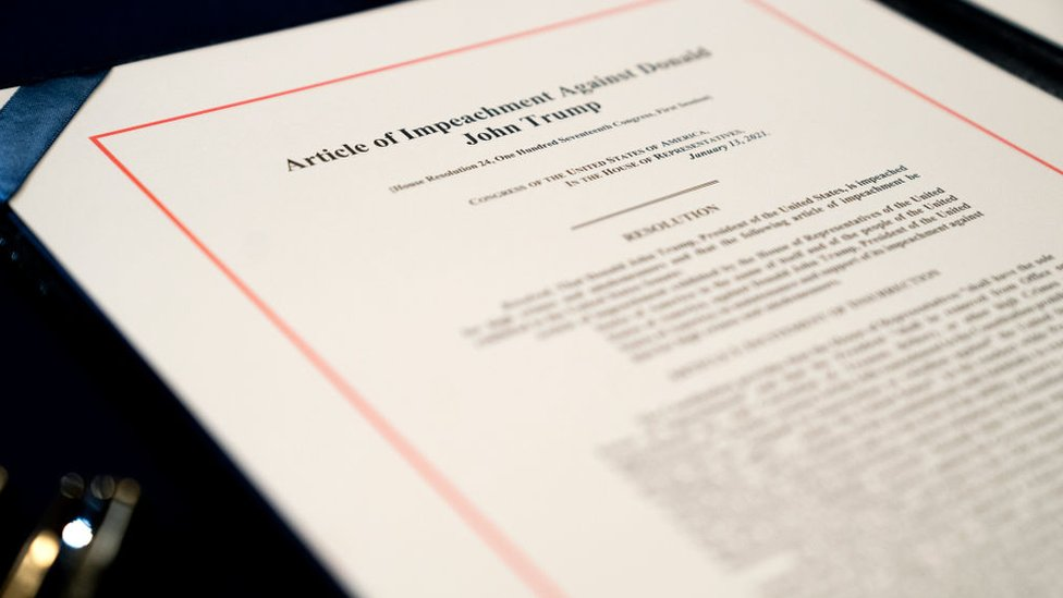 An article of impeachment for incitement of insurrection against President Donald Trump sits on a table at the US Capitol on 13 January