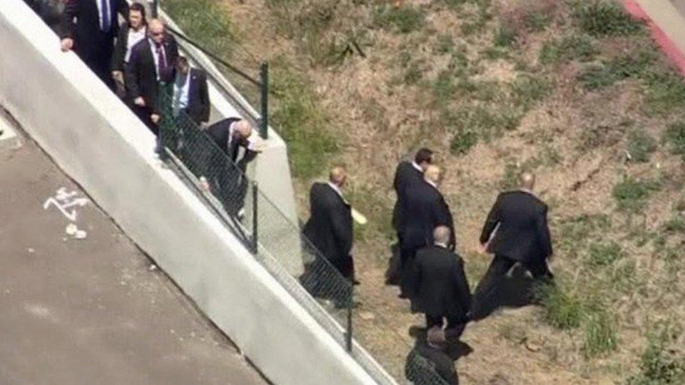 Donald Trump jumps highway barrier
