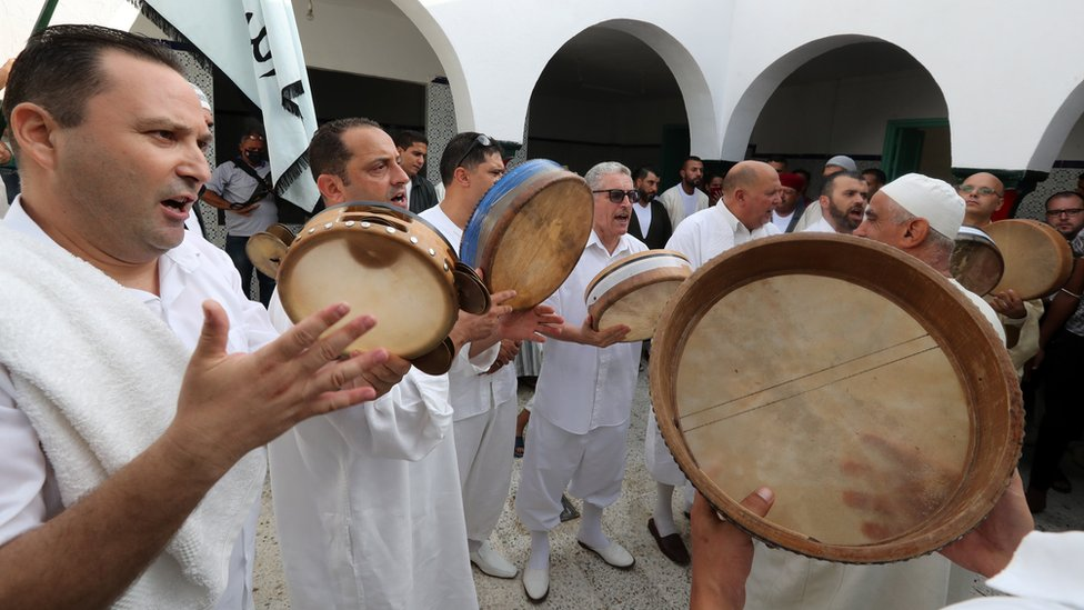 People sing at a Sufi committee gathering during Kharja Issawiya Sidi Omar Boukhtiwa, in the Sidi Omar Boukhtiwa mausoleum in Raoued in Tunis,Tunisia, 20