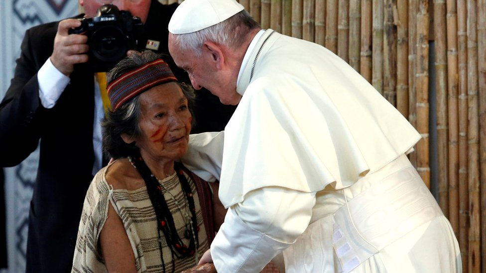 Pope Francis greets a member of a Peruvian indigenous group, at the Coliseum Madre de Dios, in Puerto Maldonado, Peru January 19, 2018