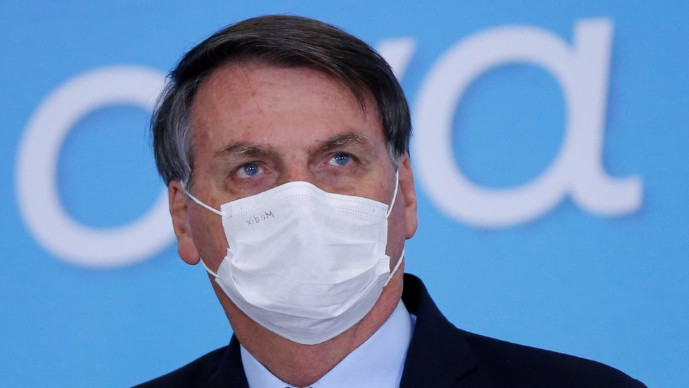 "Brazil""s President Jair Bolsonaro wearing a protective mask looks on during the launching ceremony of the Plano Safra 2020/2021, an action plan for the agricultural sector, in Brasilia, Brazil, June 17, 2020"