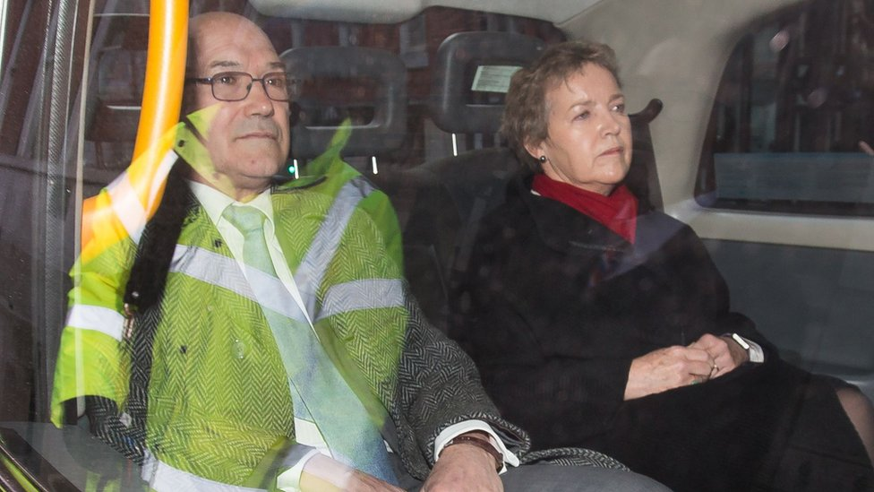 Oxfam GB's chief executive Mark Goldring and chair of trustees Caroline Thomson in the back of a car