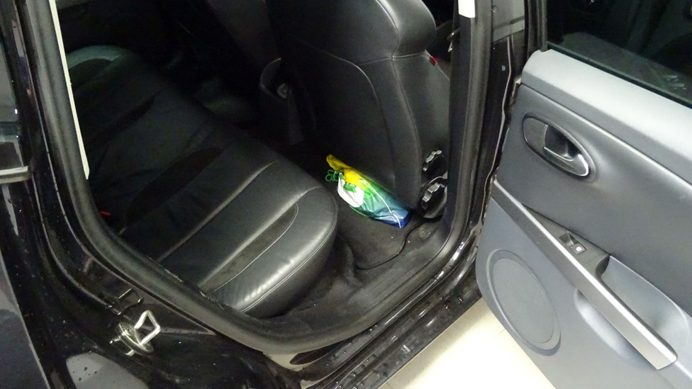 Picture taken by an MI5 officer of a bag inside Naweed Ali's car, packed under the driver's seat, in which investigators found a cleaver, replica gun and pipe bomb during a search in August 2016