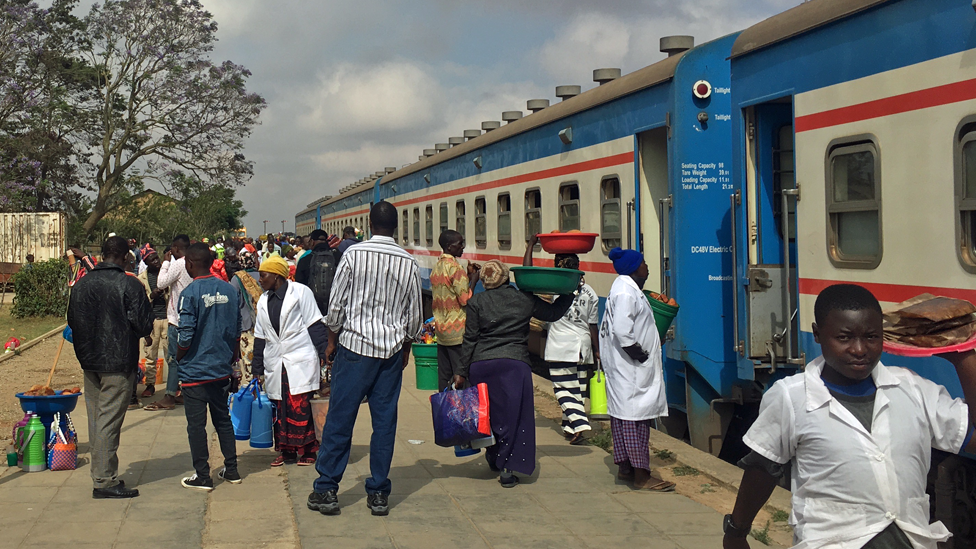 Vendors coming sell to passengers at a stop on the Tazara railway in Tanzania