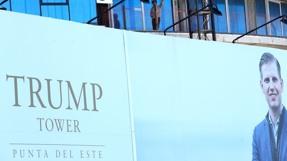A sign for Trump Tower featuring a picture of Eric Trump