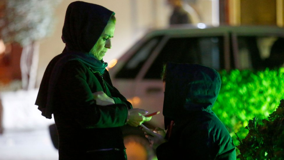 Iranian women use mobile phones in Tehran