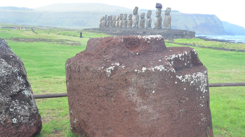 Pukao and standing Moai in distance