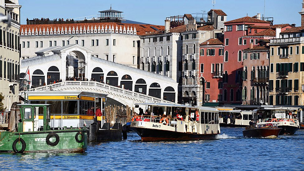 Vaporetti and other craft on the Grand Canal, Venice, by the Rialto Bridge