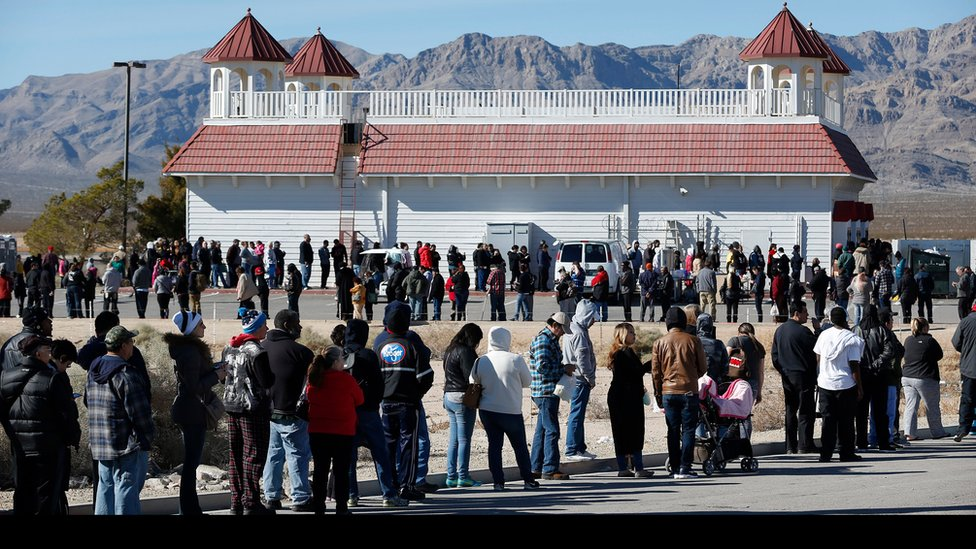 Patrons line up to buy Powerball lottery tickets outside the Primm Valley Casino Resorts Lotto Store just inside the California border Tuesday, Jan. 12, 2016, near Primm, Nevada.