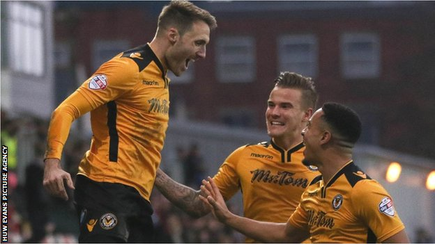 Alex Rodman celebrates his opening goal for Newport County