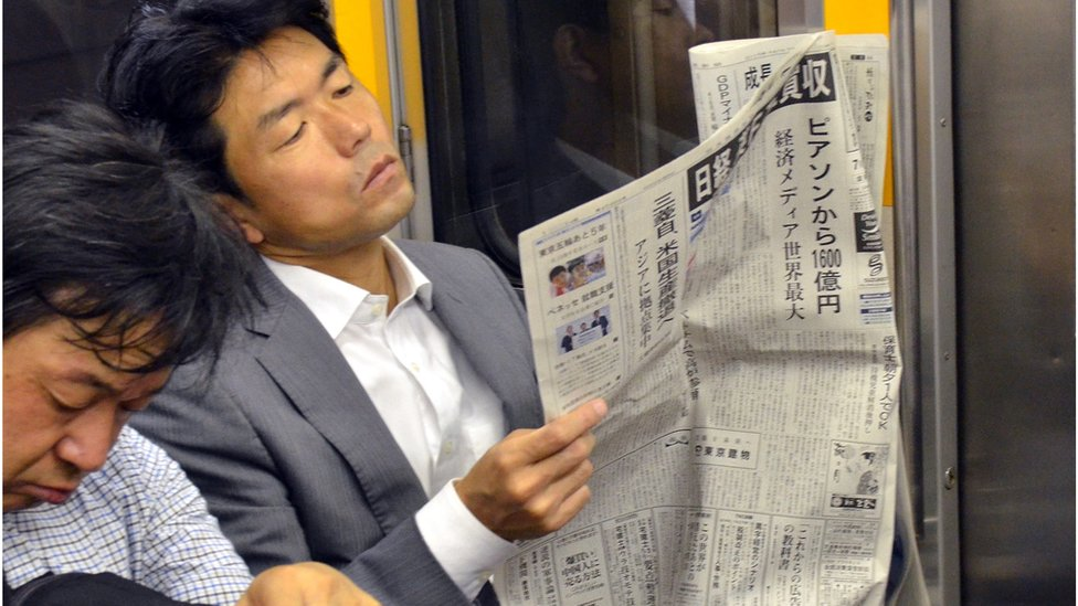 Newspaper reader in Japan