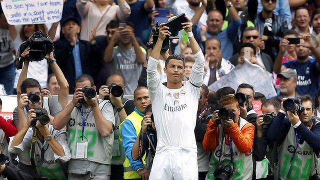 Ronaldo holds trophy