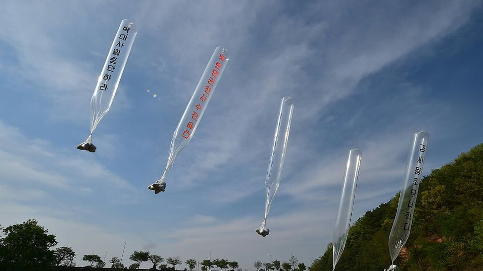 South Korean and US activists release balloons carrying anti-Pyongyang leaflets at a field near the Demilitarized zone
