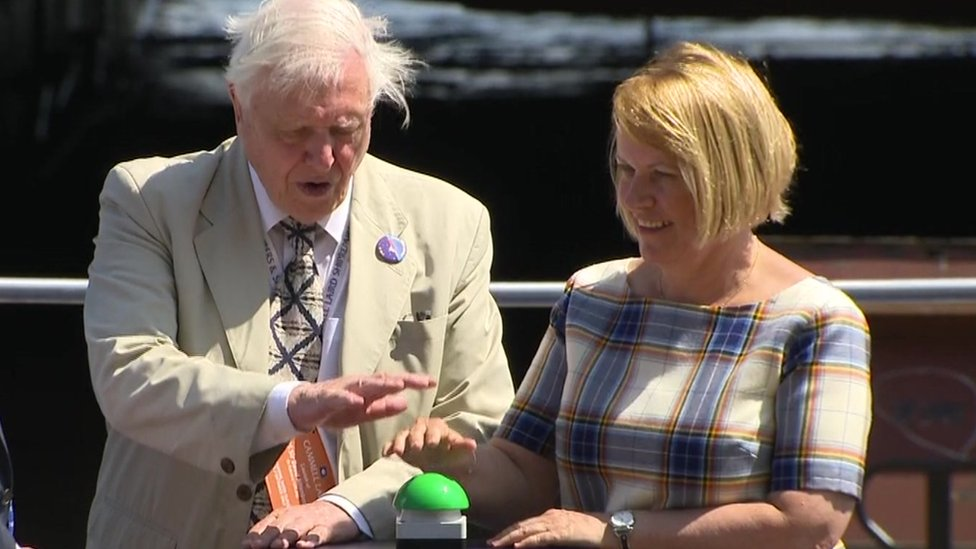 Sir David Attenborough presses button