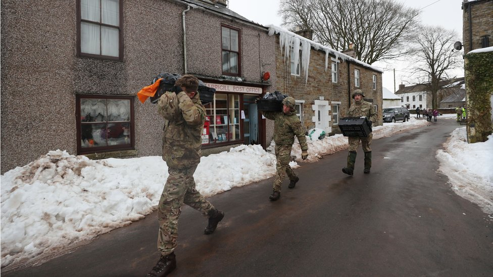Soldiers delivering supplies to parts of Cumbria