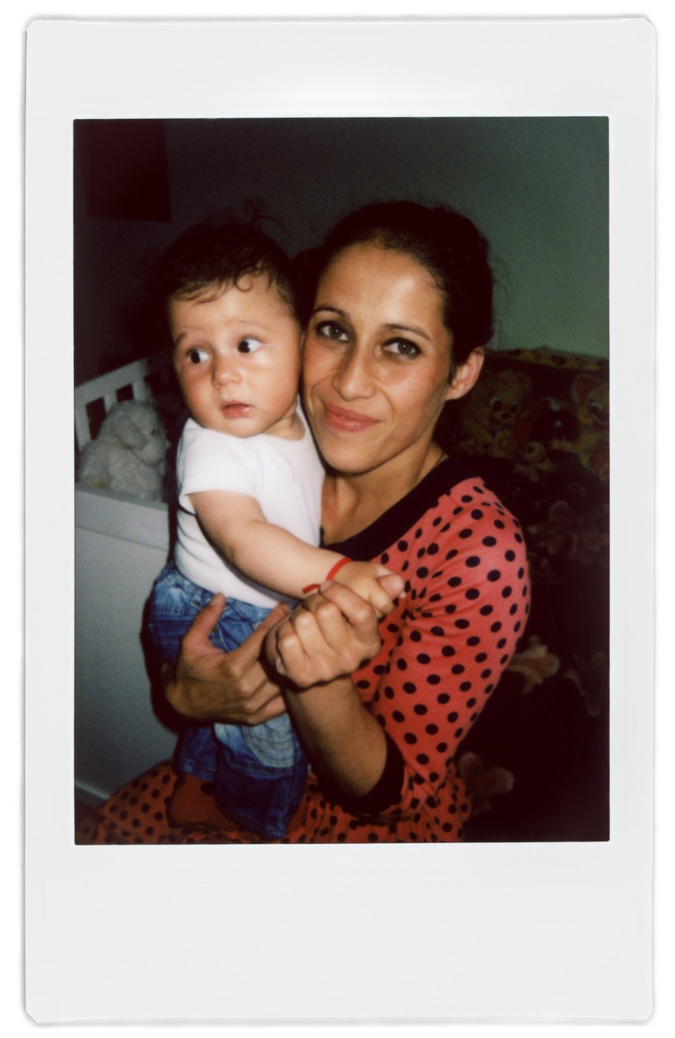 A polaroid photo of Ratha and her baby