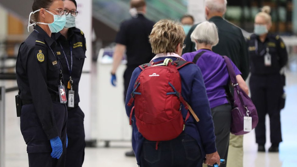 Border officials and travellers at an Australian airport