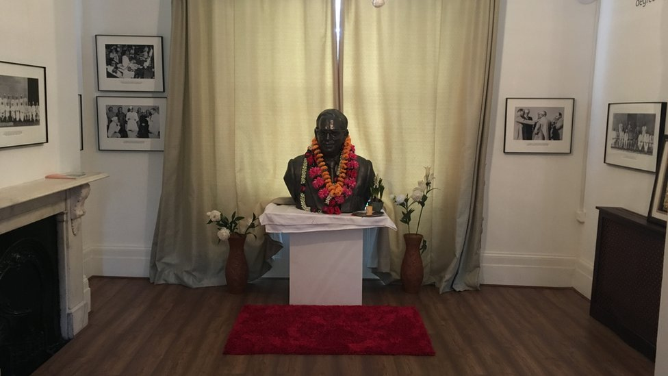 A large bust of Dr Ambedkar placed on a table inside the house in Primrose Hill