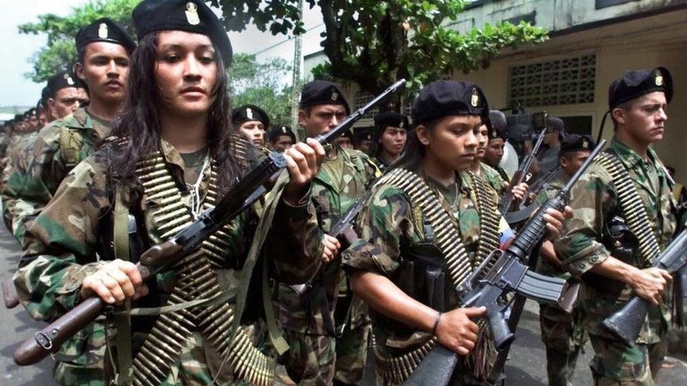 Farc guerrillas march in a military parade on 7 February 2001 in San Vicente del Caguan.