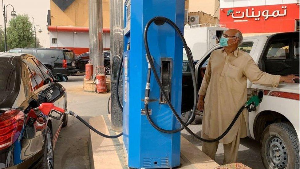 Man filling his car at petrol station in Riyadh (file photo)